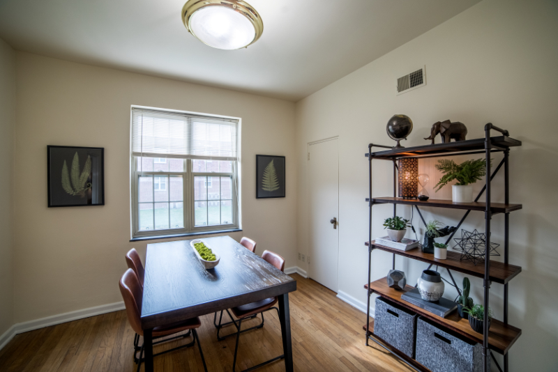 Wood table with leather seats in dining room