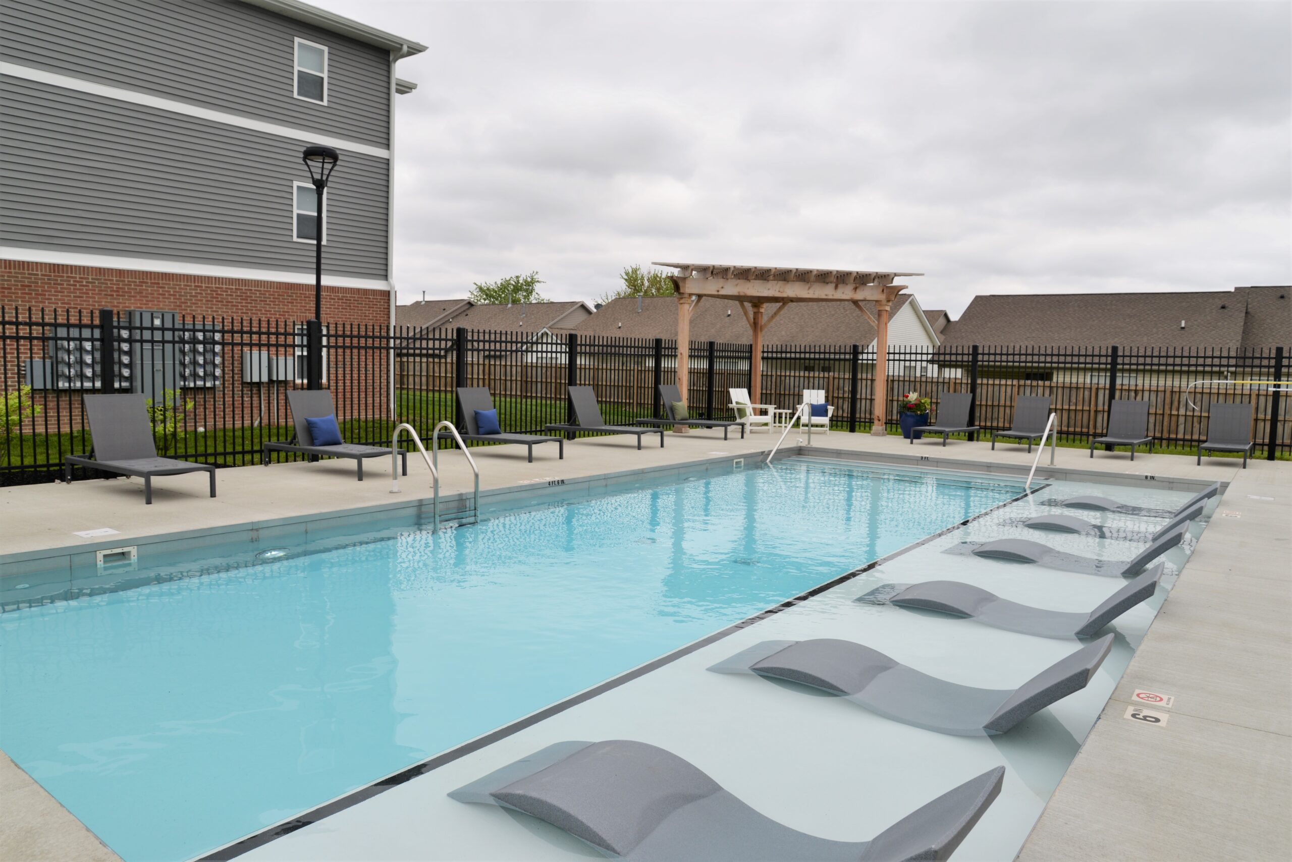 view of pool with lounge chairs