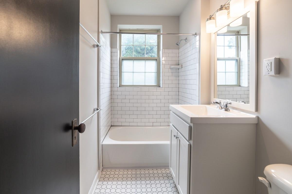 White bathroom with small white tiles